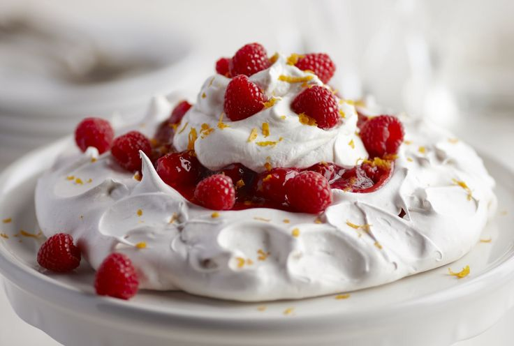 A pavlova is a large fluffy meringue often topped with fruit. Our recipe has a raspberry filling with Grand Marnier. You can make the meringue ahead and store (without the filling) in an airtight container for one to two days. To serve, add the filling and enjoy. Try this fluffy dessert out this Valentine's Day!