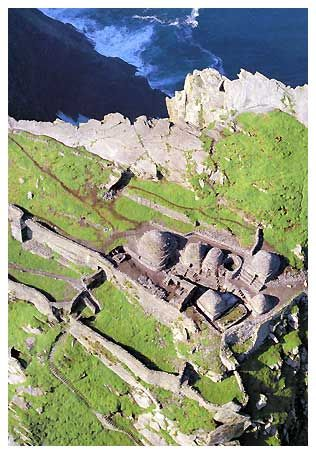 Skellig Michael Ballinskelligs, IRELAND. In the 6th century St. Fionan founded a monastic settlement on the Island. This incredible feat of engineering took place on an island some 714 feet high, lying 8 miles off the south-west coast of Ireland and involved the construction of Stone built beehive cells, retaining walls, two oratories, a church, cross slabs, two wells, stone terraces, flights of stone steps leading from their landing sights at sea level to the Monastery some 200 metres…