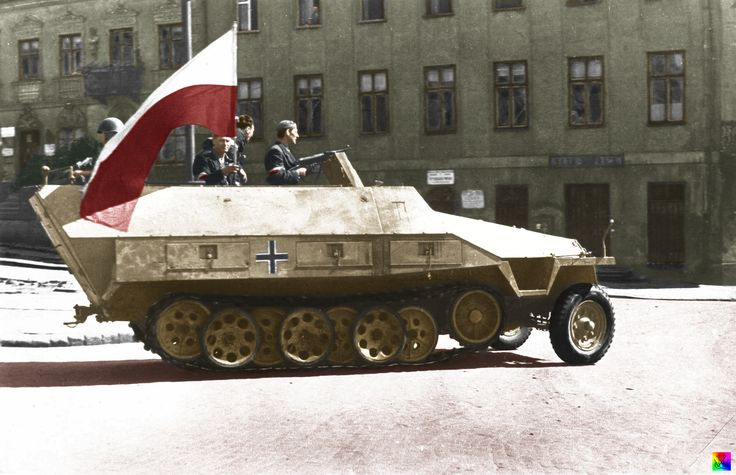 "Sd.Kfz. 251/1 Ausf. D, named ""Jaś"". It was part of the 8th motor column of Group 'Krybar' seen here on ul. Powiśla. From the right to left: plut. pchor. Adam Dewicz 'Szary Wilk' armed with an MP 40, Column Commander ppor. Wacław Jastrzębowski 'Aspira'.   It was used on the attack on the Wasraw University during which plut. pchor. Adam Dewicz ""Szary Wilk"" was killed. The vehicle was re-named ""Szary Wilk"" in his honor."