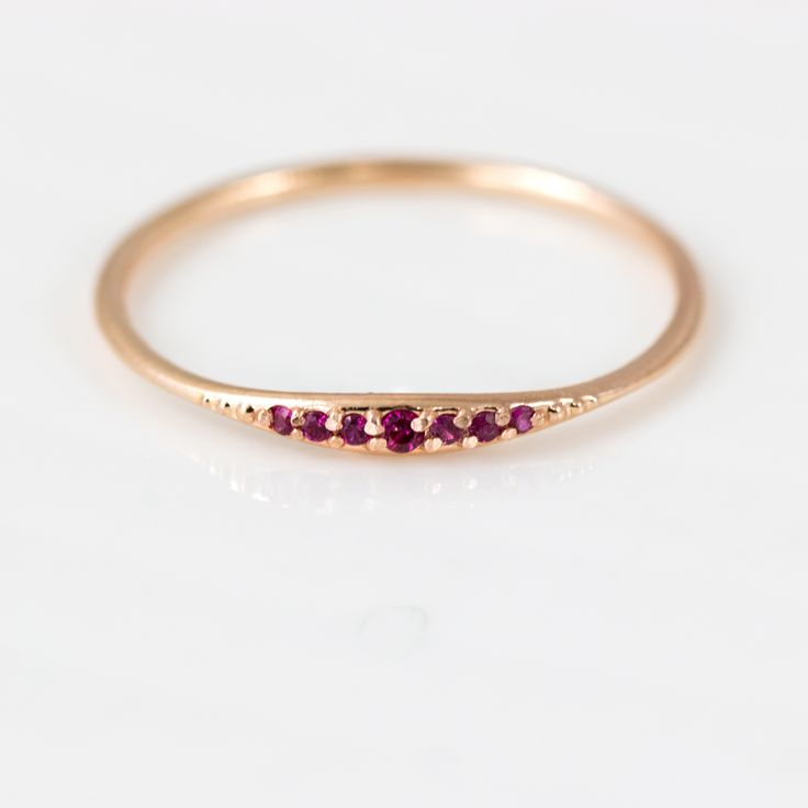 This delicate little ruby ring would make a great addition to any stacking ring set. This piece is simple and sweet, and can be customized in your choice of 14k gold metal color and finish. We hand
