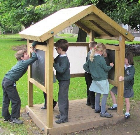 Activity Box; a Timber play hut, with black boards or white boards to the sides for artistic imaginative play