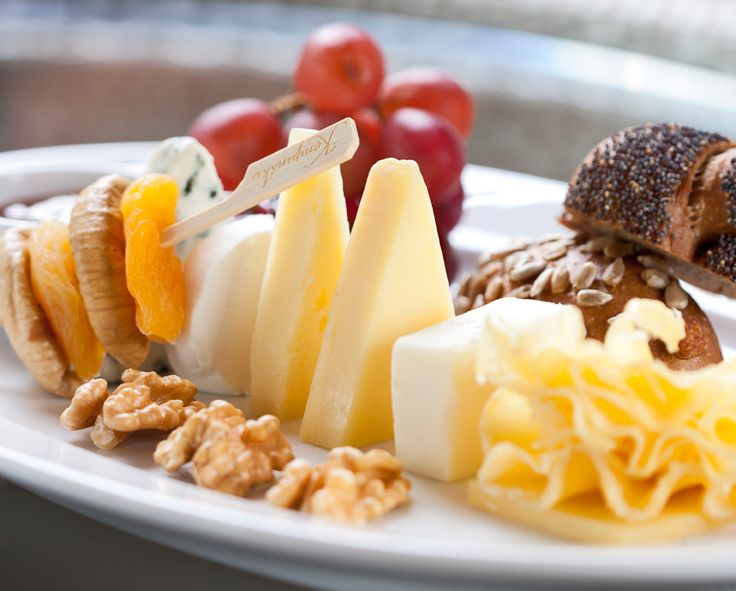 Local and international cheese platter with chutney and nut bread