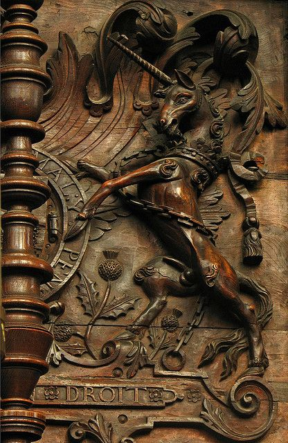 The royal arms of Scotland, carved in the 17th century onto the stalls of King's College Chapel, Cambridge University, England.  The unicorn was added to the royal arms of Great Britain after 1603, and the ascension of James I to the English throne.  by Lawrence OP