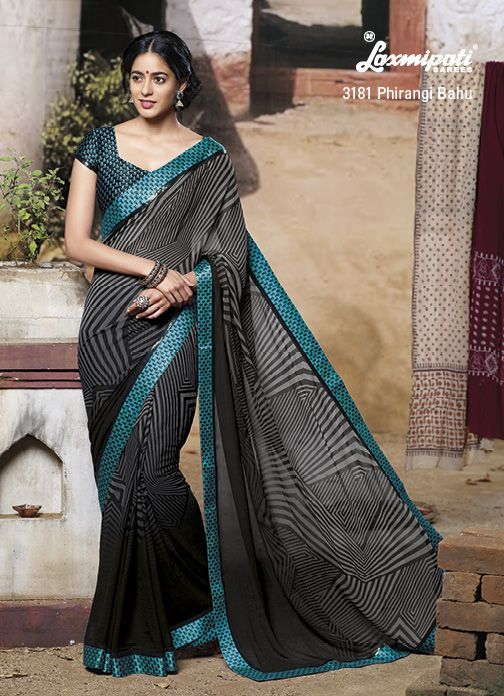 Classic black-gray zebra printed saree is looking fab with contrast silk border patti & blouse piece.