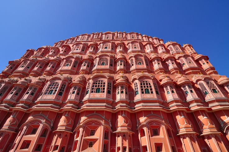 Jaipur's stunning Hawa Mahal, also known as the Palace of the Winds, served as a home to the ladies of the royal harem, who would peak out at city life from behind the intricate façade. The perfect addition to a Royal Rajasthan tour. Find tour itineraries here: http://bit.ly/2wY1aVa