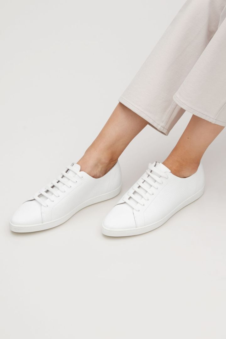 Invest in some high quality sneakers. Versatile. Pointed sneakers from COS.