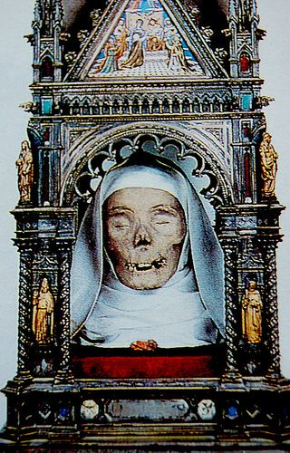 Saint Catherine's mummified head, Sienna...I've seen this, the Italians will mummify and create beautiful cases that richly decorated for different parts of saints.
