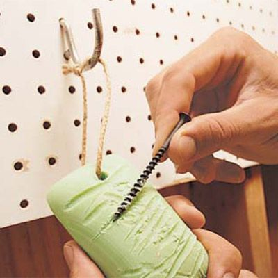 DIY Tip of the Day: Screw-lube on a String. Drill a hole through a bar of soap and hang it above your workbench. Run long screws across the soap before you drive them. They'll smoothly penetrate the wood without stripping the screw head. - Brian Bubenzer