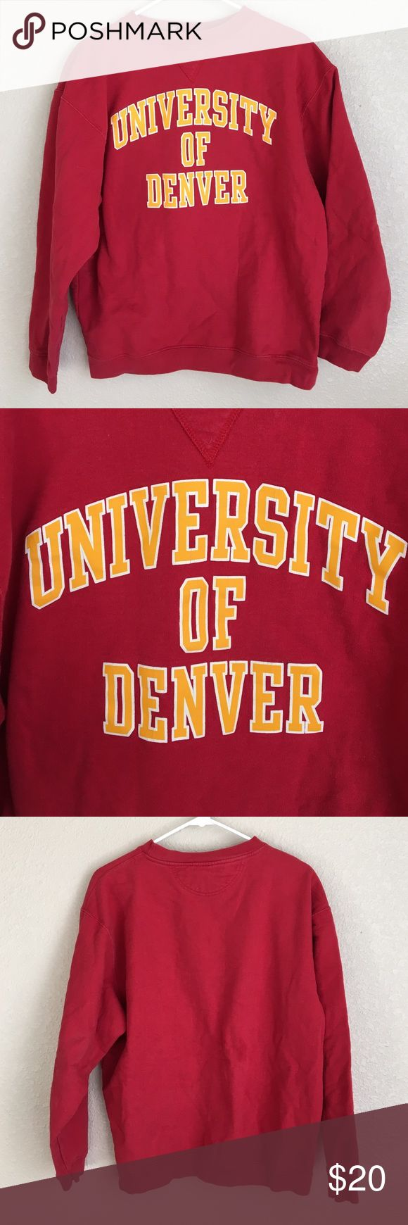 University of Denver vintage style sweatshirt DU University of Denver vintage style sweatshirt. Red with gold letters. Size L but looks like a M. Letters have some hairline cracks. There is a spot on the back of the sweatshirt. Sold as is. Haven't tried spot remover. Vintage Tops Sweatshirts & Hoodies