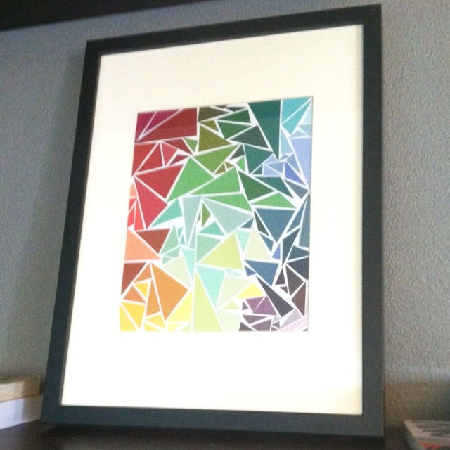 My paint-chip art. I cut triangles from paint sample cards and glued to white paper with a regular old glue stick. Voila!