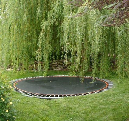 An in-ground trampoline combines fun and safety, providing room to jump and a safe place to land and roll. (1) From: Garden Logic, please visit