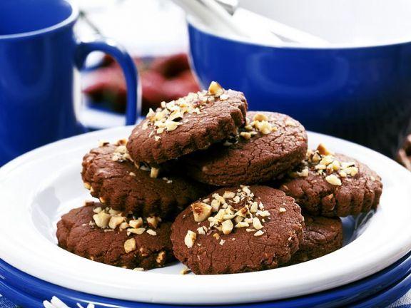 Schokoplätzchen ist ein Rezept mit frischen Zutaten aus der Kategorie Mürbeteig. Probieren Sie dieses und weitere Rezepte von EAT SMARTER!