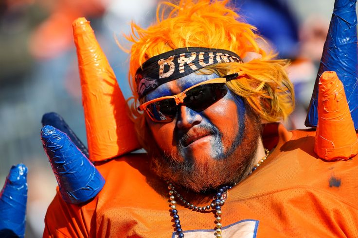 A Denver Broncos fan shows his support with face paint and a costume before a game between the Denver Broncos and the Oakland Raiders at Sports Authority Field at Mile High on December 13, 2015 in Denver, Colorado. (Photo by Doug Pensinger/Getty Images)