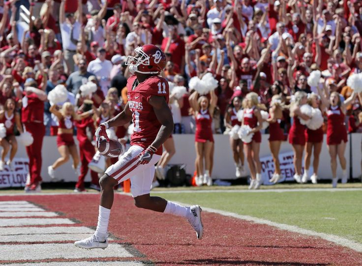 Oklahoma's Dede Westbrook (11) scores a touchdown on a long reception in the second quarter during the Red River Showdown college football game between the University of Oklahoma Sooners (OU) and the Texas Longhorns (UT) at Cotton Bowl Stadium in Dallas, Saturday, Oct. 8, 2016. Photo by Nate Billings, The Oklahoman