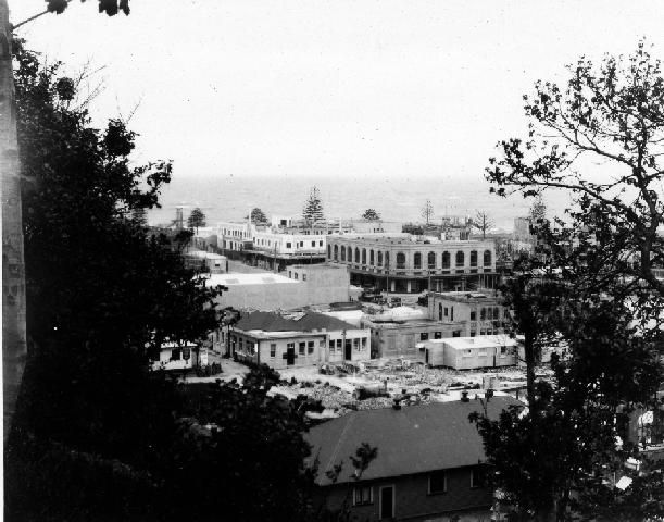 Napier Central Business District, from Tiffen Park. Rebuilding has begun after the destruction caused by the 3 February 1931 Hawke's Bay earthquake. The Market Reserve building, which is the photograph, was completed in June 1932. Dave Williams, photographer. Post 03 Feb 1931