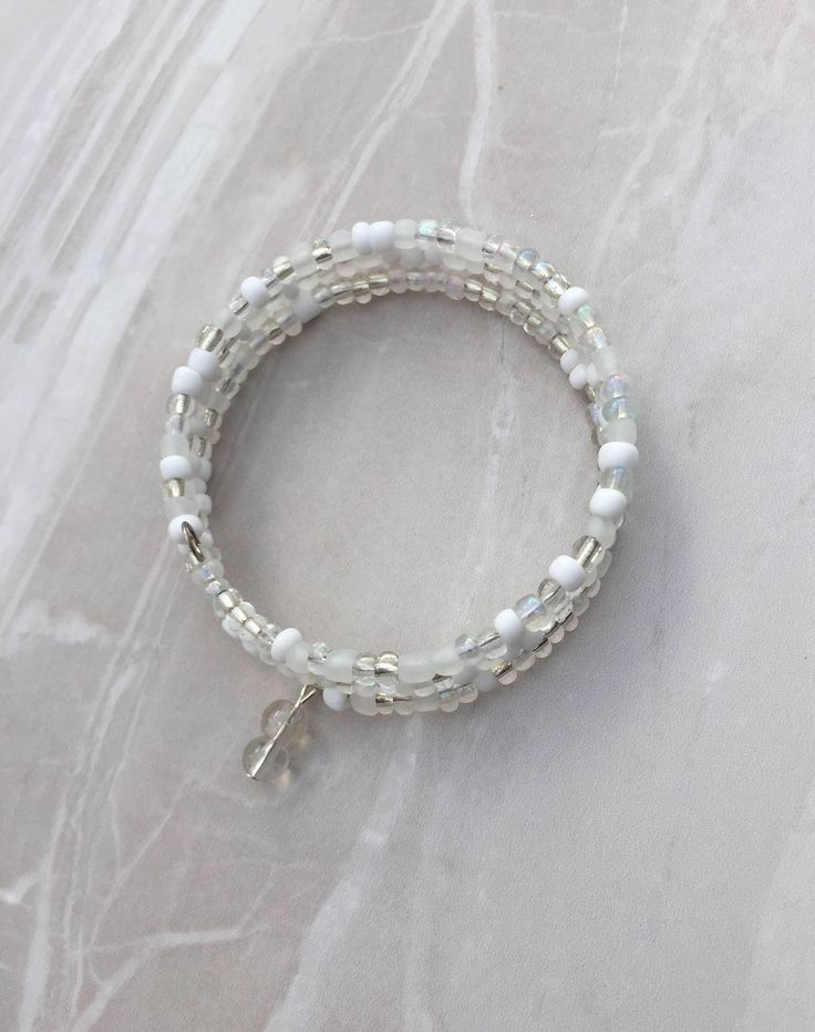 A personal favourite from my Etsy shop https://www.etsy.com/uk/listing/523284891/white-beaded-memory-wire-bracelet-beaded