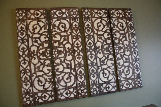 BEAUTIFUL...and DIY..take 4 stained boards, put a Lowe's plastic doormat on top and spray paint with Cream color or any color u like..REMOVE and THIS is what u have for ur WALL!!  ~The French Flea