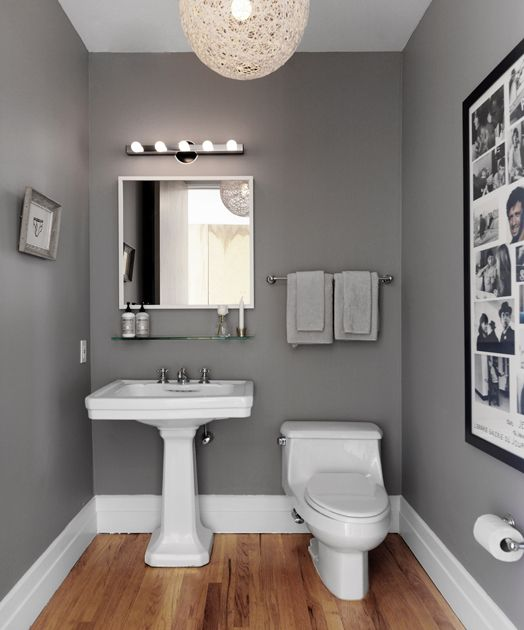 Powder Room With Steel Gray Walls And White Twine Pendant Over Oak Hardwood Floors