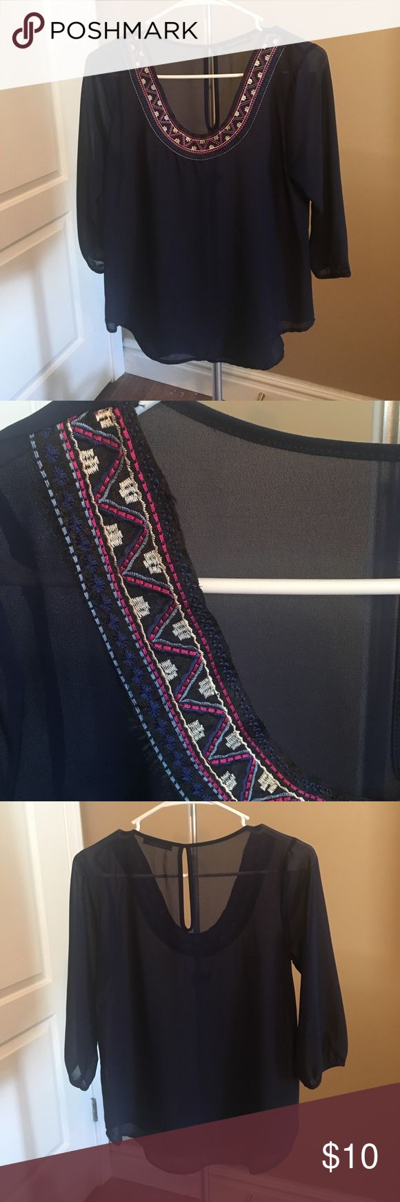 Embroidered neckline blouse Sheer navy blouse with adorable embroidered detail around the scoop neckline. Keyhole opening in back and 3/4 sleeves. Worn once, purchased from Apricot Lane Boutique jella couture Tops
