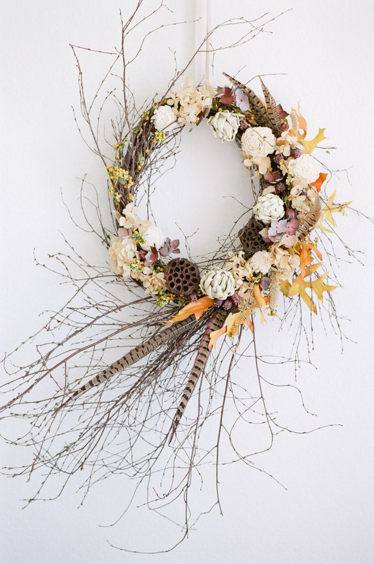 DIY Fall Wreath Photography : Tamara Gruner Photography Read More on SMP: http://www.stylemepretty.com/living/2016/09/28/give-your-front-door-the-prettiest-fall-makeover-with-this-easy-diy/