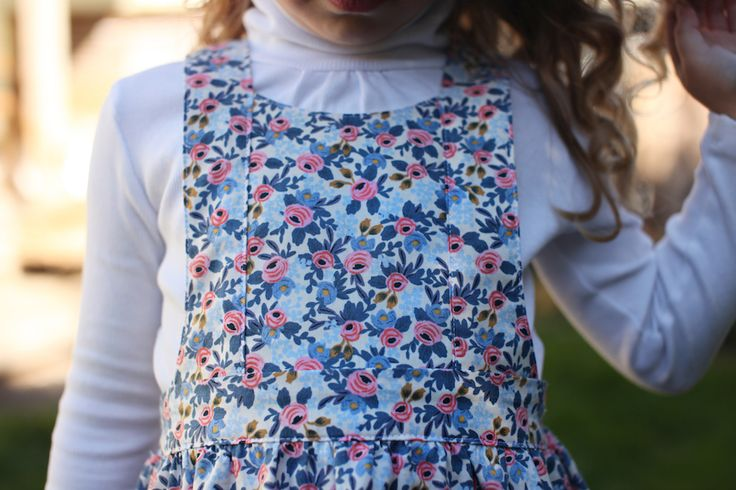 The Tui Pinafore PDF sewing pattern  by Below The Kōwhai $14 in sizes 1-10 || It comes with 2 different options for the bodice and straps. This is the curved options.