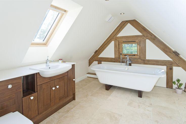 Less is more in this bathroom with minimal oak frame on show but creating maximum impact. www.welshoakframe.com #oakframe #bathroomideas #freestandingbath #oakframebathroom #bathroom #dream #relax #modern
