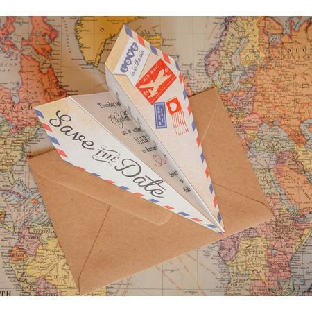 Gorgeous vintage travel themed paper plane (airplane / aeroplane) Save the Dates with pretty airmail (air mail), postcard, map and stamps details - perfect for a destination wedding. Order as an instant digital PDF printable, cards or magnets. Customise/Personalise online with live previews as you type. All our invites and wedding stationery designs have matching items including invitations, RSVPs and more. Bespoke work also undertaken.
