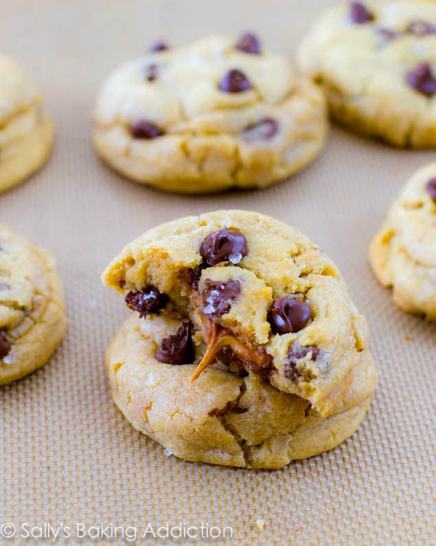 Salted Caramel Chocolate Chip Cookies. These extremely thick, puffy, soft, and chewy chocolate chip cookies are stuffed with gooey caramel a...