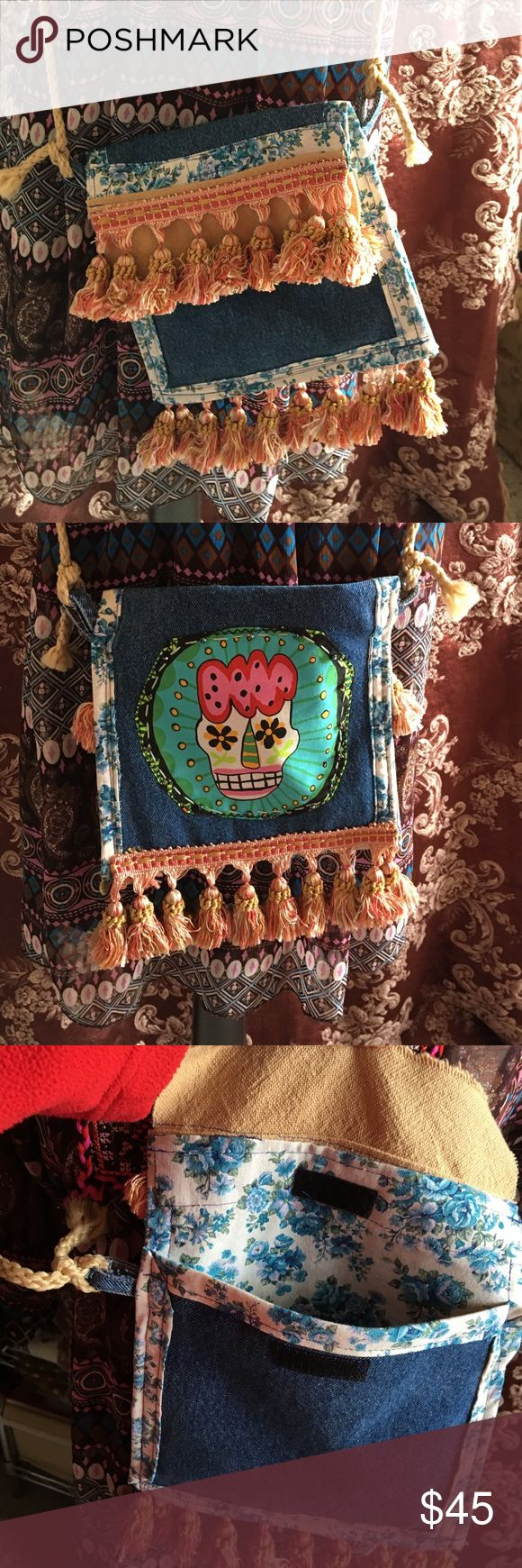 BoHo Hippie Festival Bag Day of the Dead Crossbody Handmade by me for my boutique. This is a one-of-a-kind festival cross body bag. Lots of Fringe & Tassels and fun details. This bag has an extra long rope handle that can be tied to make it different lengths. A Velcro closure for safekeeping of your items and an inside pocket. Day of the dead sugar skull design with hand beading details on one side and tassels and fringe on the other. Measurements 8 x 9 inches when closed and handle is very…