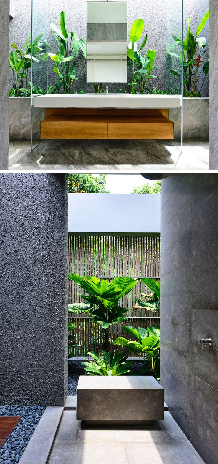 This bathroom is full of natural materials and tropical plants.