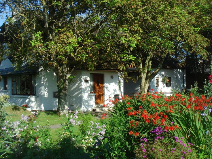 Set in the picturesque organic flower gardens, Garden Cottage is full of character and charm providing an exceptional standard of holiday cottage accommodation for two or four people.