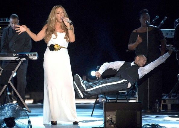 Mariah Carey Photos Photos - Mariah Carey wears a strapless white gown as she performs in concert at the Stade Louis II. - Mariah Performs in Monte Carlo