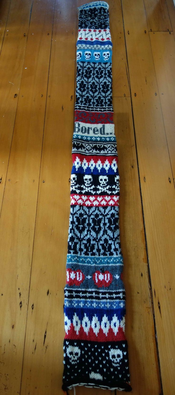 Knitted Sherlock scarf (http://professorfonz.tumblr.com/post/48741987970/knitting-is-boring-pattern-selections-here-are)