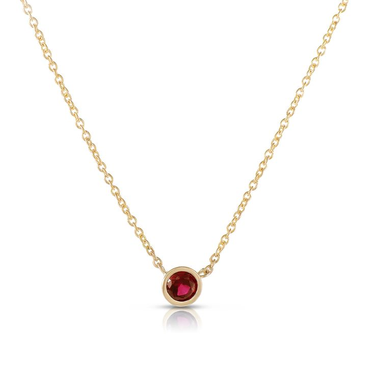 This 14k solid yellow gold ruby necklace is simply elegant. Made with an excellent cut round 2.8mm ruby in a tube bezel setting for a sweet touch of charm day or night; beautiful alone or layered with