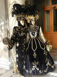 Couple in black, silver, and gold