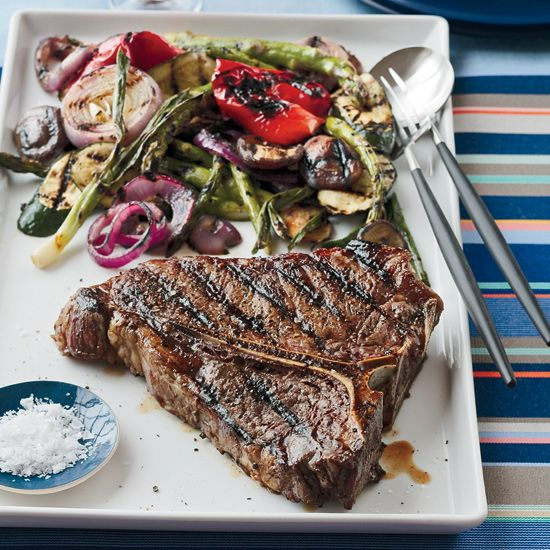 Grilled Porterhouse Steak with Summer Vegetables | Chef Kerry Simon grills steak and vegetables over a hot charcoal fire, then smokes a whole chicken over the smoldering coals to eat later.