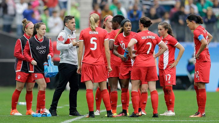 Canada coach John Herdman, 3rd left, talks with his players during the 2016 Summer Olympics football match between Canada and Australia, at the Arena Corinthians, in Sao Paulo, Brazil, Wednesday, Aug. 3, 2016. (AP Photo/Nelson Antoine)