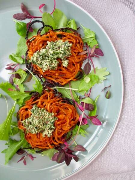 Learn how to use carrot tops to make this DELICIOUS pesto that can be enjoyed in a number of different ways. Pair it with the spiraled carrot nests found on the blog, or spread it on some sourdough toast. Click through to read a few easy tips to help you reduce food waste. #tasteandseeblog #pesto #reducewaste #foodwaste #easyrecipe #basicrecipe