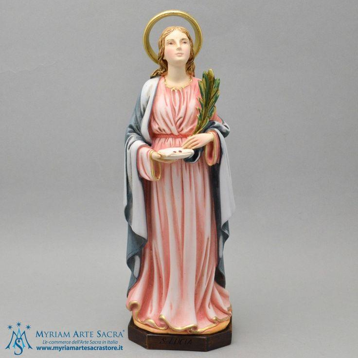 Statua Santa Lucia realizzata in resina. Dipinta a mano, con cura in ogni dettaglio. Made in Italy. Scatolata.  H 30 CM