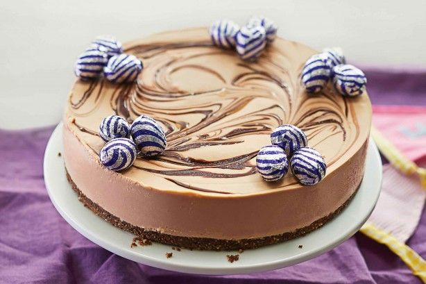 Top off this rich chocolate cheesecake with mini chocolate eggs for a fun Easter touch!