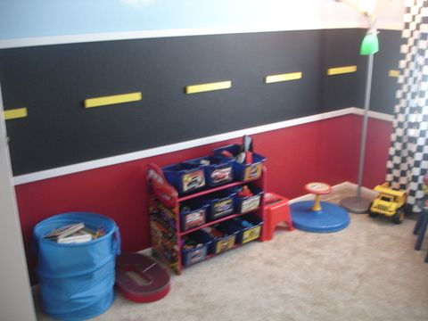Little Man, This is our sons bedroom.  He loves cars planes and trains.  We wanted to do a room that could grow with him as he is only 2 years old.  The top half of the walls are sky the middle a road using black chalk board paint and the bottom red.  He loves his room!, This is the other side of the room where he has storage for toys the road goes all the way around the room, Boys Rooms Design