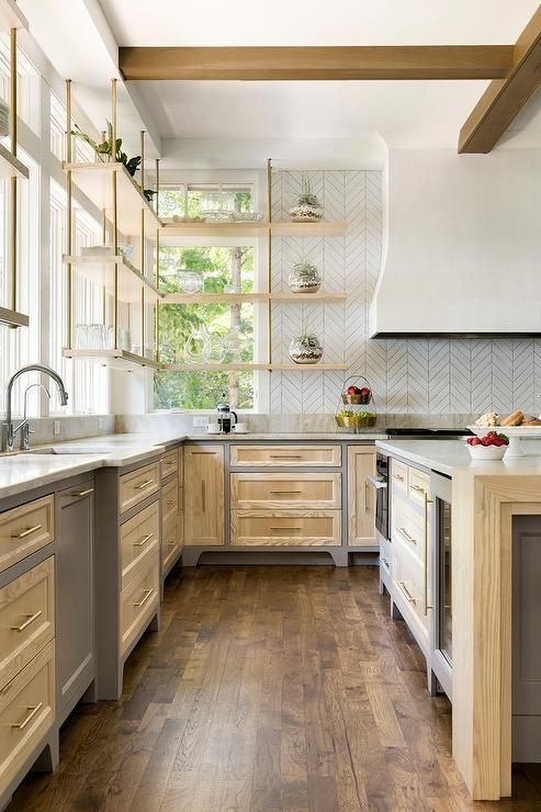 two toned charcoal gray and ash wood kitchen cabinetry is accented with antique brass pulls and on kitchen interior grey wood id=83802