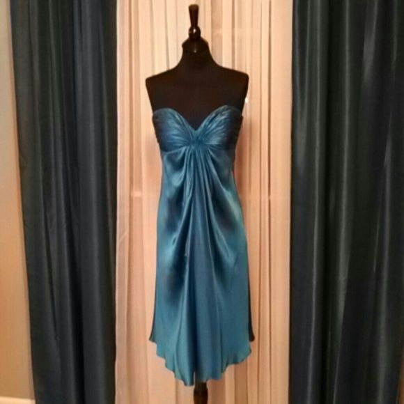 SUPER CHIC Laundry Dress - Strapless Silk - Size 8 The beautiful azure colored flowing silk and ruching details make this dress a show stopper. It is very well made with full lining and boning in the bodice. It has only been worn twice and looks amazing on. Flatters curves and hides trouble spots at the same time! Has been dry cleaned. Laundry Dresses