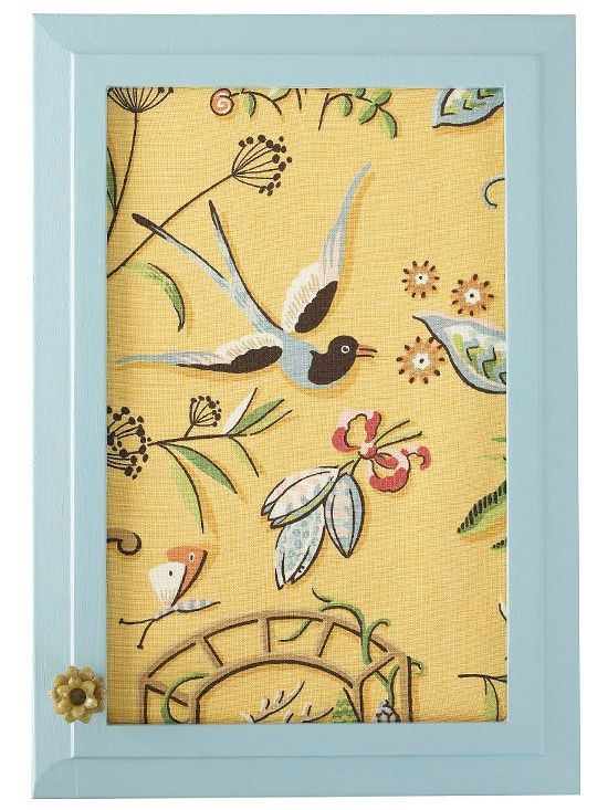 Fabric insert in cabinet door. I like the idea of having only one decorated door