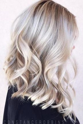 The Biggest Hair Color Trends For 2018 | Booking color appointments ASAP. Changing your hair color can be as subtle as a few highlights or as drastic as a coat of bright purple. We've seen all colors of the rainbow surge in popularity the past few years, but for 2018, hair color is looking much more laid-back. That's not to say that there aren't some popular hair colors that Mama wouldn't gasp over, but the hair color trends for 2018 are less drastic than you might think.
