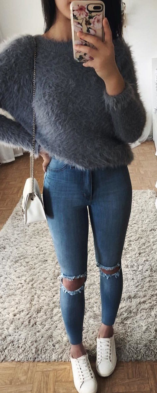 #winter #outfits gray fur sweatshirt and distressed blue denim pants