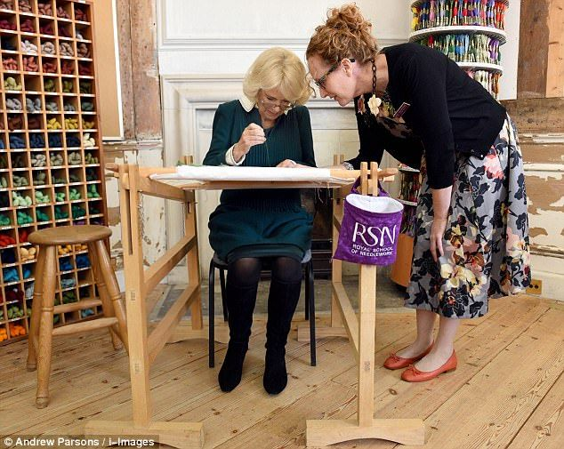 The Duchess of Cornwall tried her hand at needlework today as she visited the Royal School...