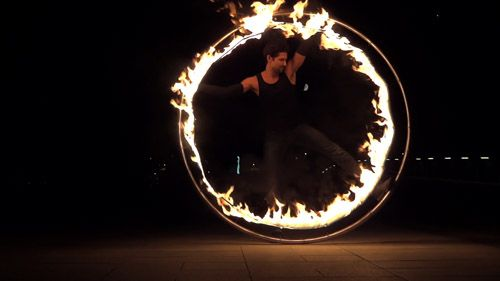 Fire and LED cyr wheel | Cyr Wheel | Wheels | Circus performers | Performers | Entertainment Agency | Corporate Event Entertainment