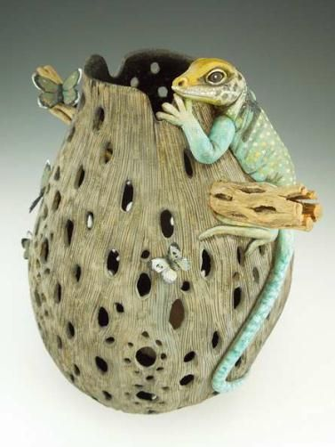 """Featured Gourd of the Month:""""Snacktime""""Carved gourd with added cholla wood, Collared Lizard made fromApoxie Sculpt, andbrass butterflies.By Bonnie Gibson"""