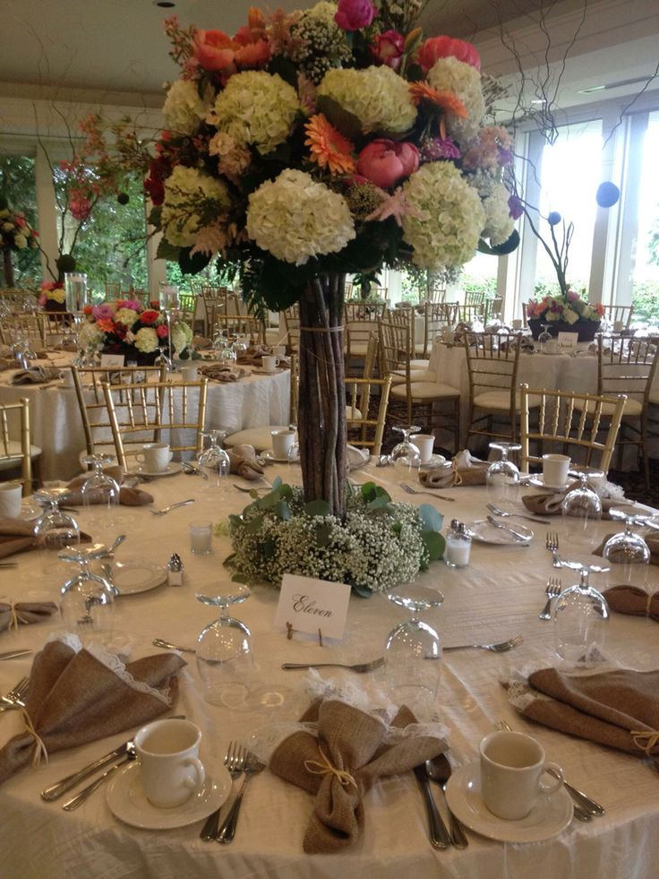 Gorgeous woodland wedding done by #AffairsToRemember with lace burlap napkins and creamy ivory linens. #michiganwedding #wedding #rustic #shabbychic #hydrangeacenterpiece #ecofriendly #babysbreath #elegant